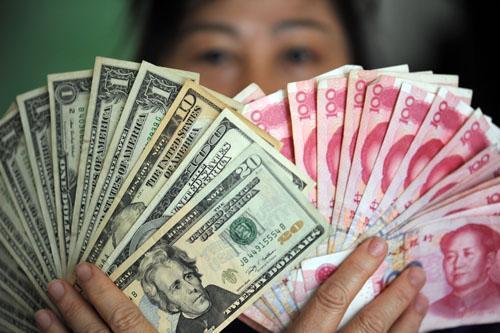 外媒称人民币将成世界货币:5年万亿美元流入中国