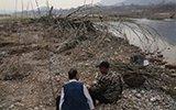 洪水冲毁15年植树成果 残疾哥俩重头再来