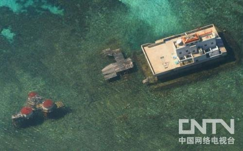 菲军舰试图逮捕中国渔民 与中国巡逻船南沙对峙
