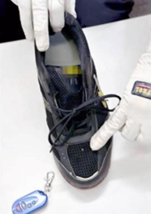 日本警方查获数百双可偷拍裙底运动鞋图 粤