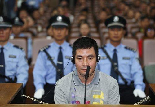 """""""10·5""""湄公河惨案被告人糯康在庭审现场。新华社记者 王申摄"""