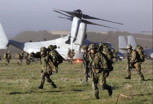 日本执政党通过新防卫大纲建议将扩编自卫队