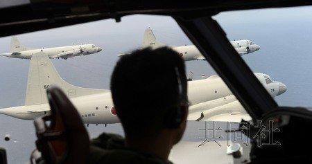 """日本记者搭自卫队巡逻机""""监视""""钓鱼岛海域"""