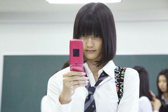狠狠射色情照片_日本小学老师拍摄学生照片 被视为儿童色情片