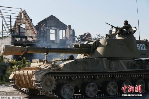 乌东部签停火备忘录 俄罗斯北约均表示欢迎