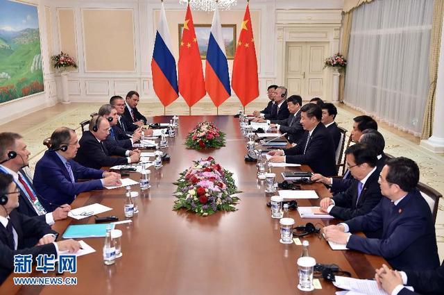 6月23日,国家主席习近平在乌兹别克斯坦塔什干会见俄罗斯总统普京。新华社记者李涛摄