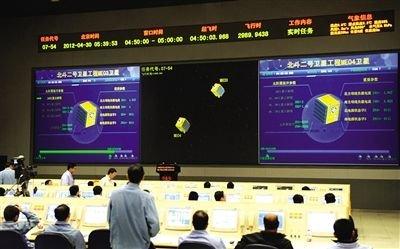 工作人员在西昌卫星发射中心指挥大厅。新华社记者 陶明 摄