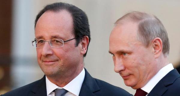 普京与奥朗德。法国总统奥朗德的斡旋,在共同打击ISIS上非常重要