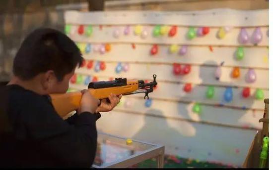 射击摊上的气枪,很可能被认定为枪支