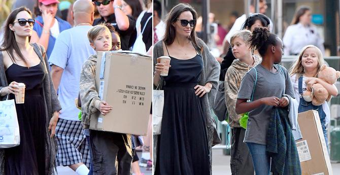 """朱莉带孩子外出扫货 """"小正太""""希洛变搬运工"""