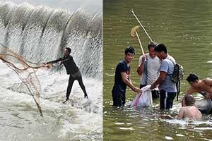 太原市民用大网、电棍在堤坝涉险捞鱼