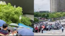 合肥市民冒雨排长队接种疫苗