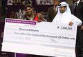 组图:小威总决赛夺冠 颁奖仪式接过巨额支票