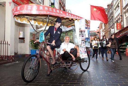 中国农民骑三轮环游世界 奥运狂人目的地里约