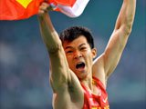 劳义获中国亚运百米首金