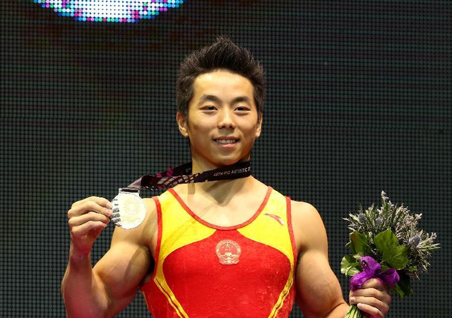 从替补到世锦赛金牌得主 尤浩双杠上完成蜕变