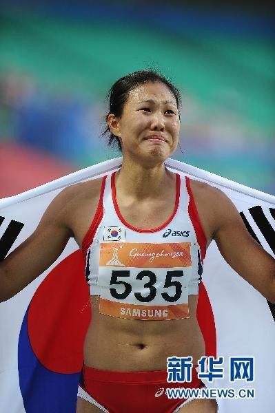 韩国选手李莲京女子100米栏夺冠(组图)