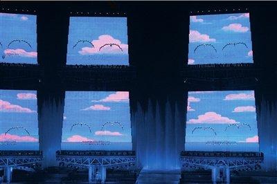 揭秘如何点燃亚运火炬 舞台中心升降台藏玄机