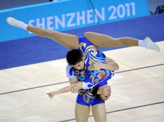 中国健美操组合为何夺金? 完成分高出俄组合