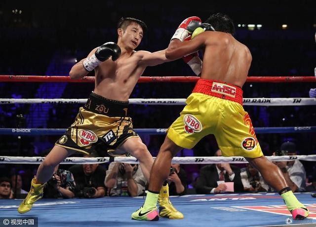 邹市明点胜泰拳手夺世界金腰带 生涯成就大满贯