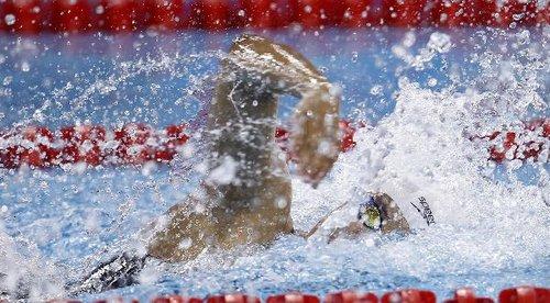 14日综合:澳门喜获亚运首金 中国游泳势头惊人