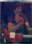 不满6个月的C小罗躺在奶奶的怀中…