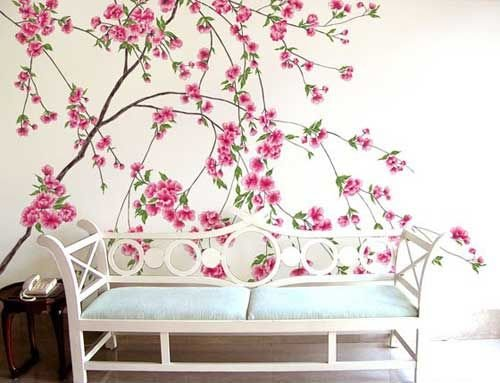 手绘墙画是用丙烯颜料在墙面上