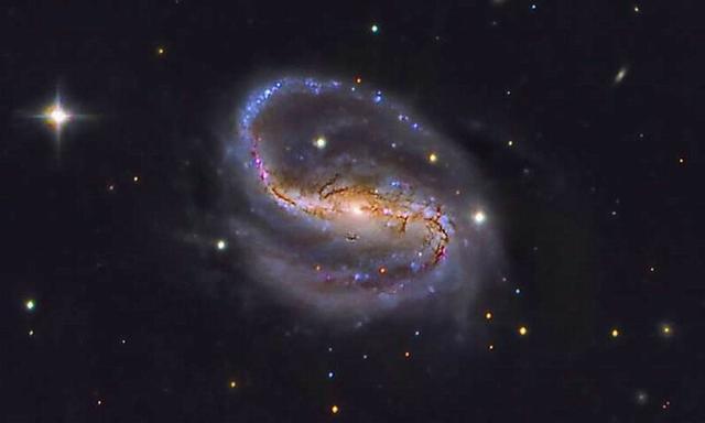 星系棒旋转速度比预期更慢暗示暗物质存在