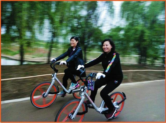 """摩拜共享单车来汉一周 """"橙色潮流""""引发深度思考"""