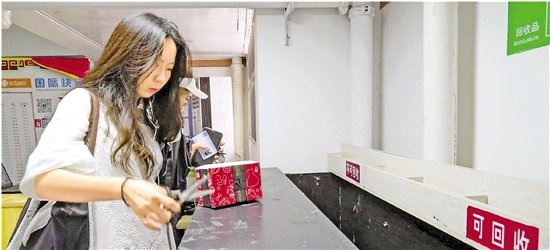 中国日均包裹数超一亿 物流包裹何日换绿装?