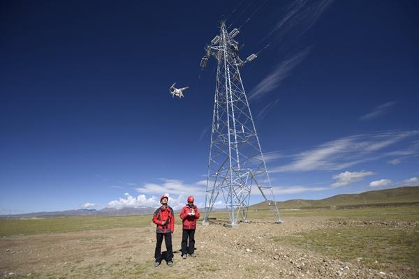 国网浙江电力帮扶西藏电网 首次采用无人机验收线路