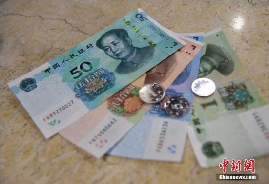 人民币图样使用管理办法施行:对人民币不能拒用乱用