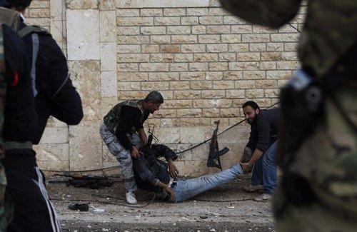 叙利亚死人图片_澳大利亚政府警告国人不要参与叙利亚内战_新闻_腾讯网