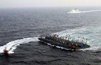 韩武力扣押3艘中国渔船